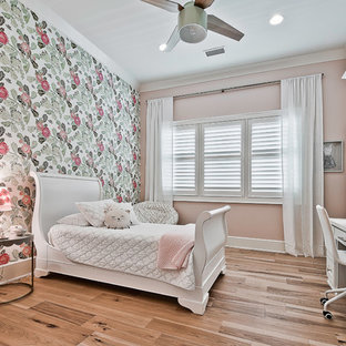 Inspiration for a large craftsman guest light wood floor and brown floor bedroom remodel in Other with pink walls