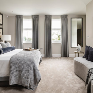 Design ideas for a large contemporary master bedroom in London with grey walls, carpet and beige floors.