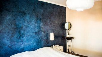 Blue marmorino wall in bedroom.