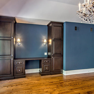 Bedroom - large traditional master medium tone wood floor and brown floor bedroom idea in San Francisco with blue walls and no fireplace