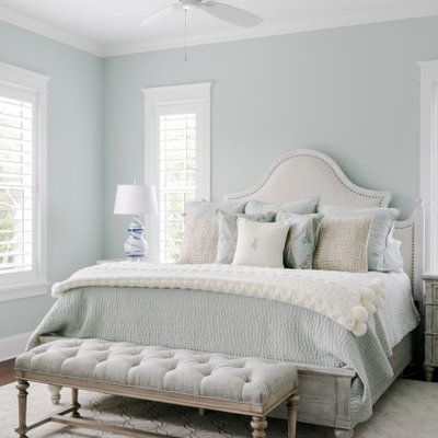 Inspiration for a mid-sized coastal master dark wood floor and brown floor bedroom remodel in Jacksonville with green walls