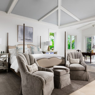 Photo of a large transitional master bedroom in Miami with white walls, no fireplace, beige floor and marble floors.