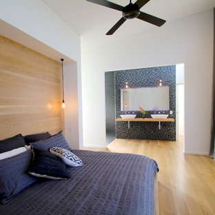 Bedroom - large contemporary master light wood floor bedroom idea in Sydney with white walls