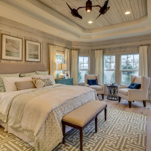 Mid-sized coastal master light wood floor bedroom photo in Miami with gray walls and no fireplace