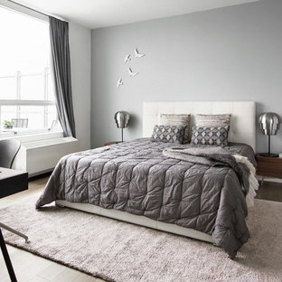 Inspiration for a contemporary medium tone wood floor bedroom remodel in London with gray walls
