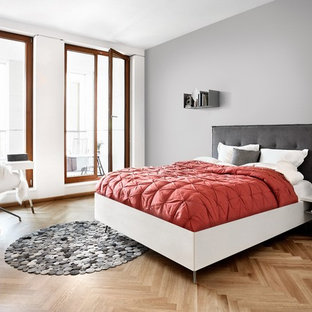 Design Ideas For A Scandi Bedroom In London With Grey Walls And Light  Hardwood Flooring.