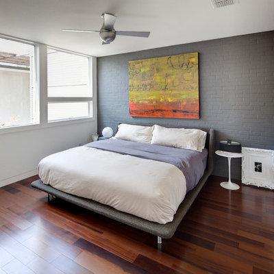 Bedroom - modern dark wood floor and brown floor bedroom idea in Dallas with multicolored walls