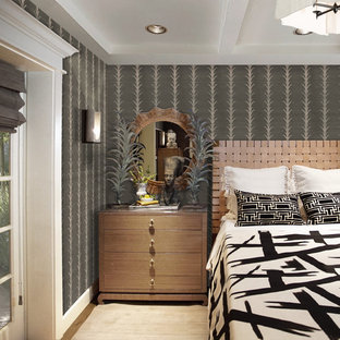 Design ideas for a mid-sized eclectic guest bedroom in Phoenix with grey walls, medium hardwood floors, no fireplace, brown floor, coffered and wallpaper.