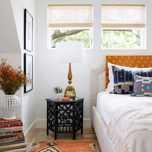 Inspiration for an eclectic light wood floor bedroom remodel in Minneapolis with white walls