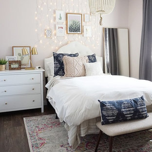 Inspiration for a mid-sized eclectic guest vinyl floor and brown floor bedroom remodel in Phoenix with pink walls