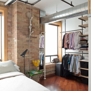 Inspiration for a mid-sized industrial master medium tone wood floor and brown floor bedroom remodel in Toronto with white walls and no fireplace