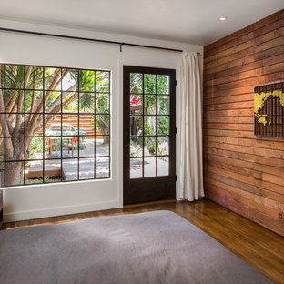 Mid-sized trendy master medium tone wood floor and brown floor bedroom photo in Los Angeles with white walls and no fireplace