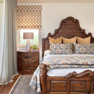 Elegant dark wood floor and brown floor bedroom photo in Austin with white walls