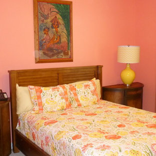 Example of a large eclectic guest carpeted bedroom design in Miami with pink walls and no fireplace