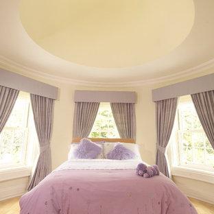 Bedroom - traditional light wood floor bedroom idea in London with beige walls