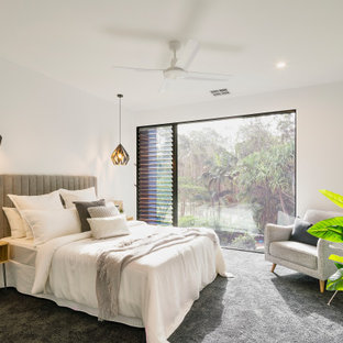 Inspiration for a contemporary guest bedroom in Sunshine Coast with white walls, carpet, no fireplace and grey floor.