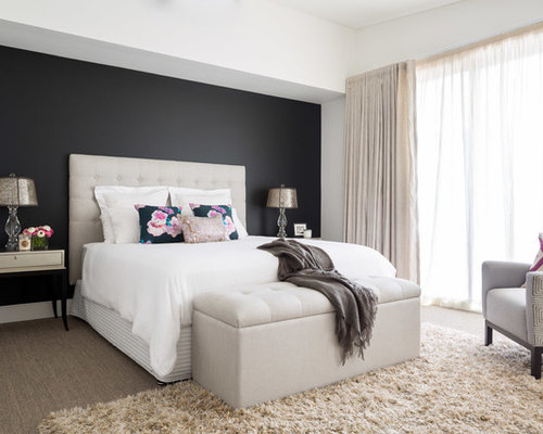 Example of a trendy master carpeted bedroom design in Sydney with black  walls