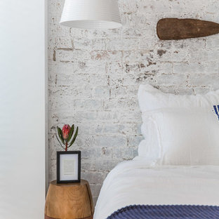 This is an example of an eclectic bedroom in Sydney with white walls, carpet and beige floor.