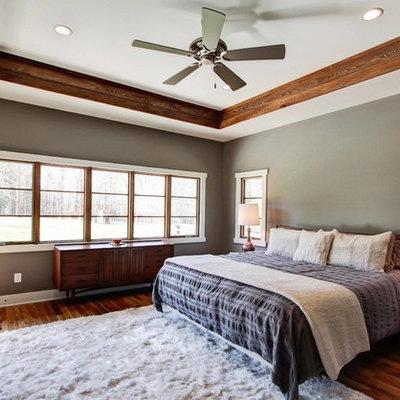 Bedroom - contemporary medium tone wood floor bedroom idea in Other with gray walls