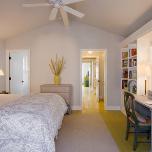 Photo of a transitional bedroom in Austin with grey walls and yellow floor.