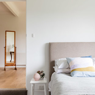 Contemporary guest bedroom in Newcastle - Maitland with white walls and carpet.