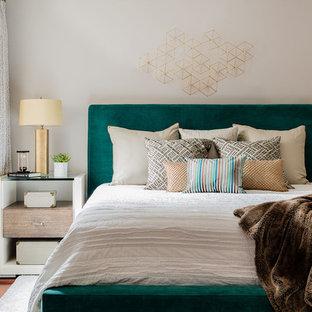 Mid-sized trendy master medium tone wood floor bedroom photo in Boston with gray walls