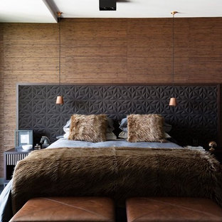 Photo of a contemporary bedroom in Sydney with brown walls, carpet and grey floor.