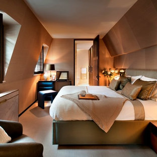 This is an example of a contemporary bedroom in London with carpet and brown walls.