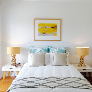 Design ideas for a contemporary bedroom in Sydney with white walls and light hardwood floors.