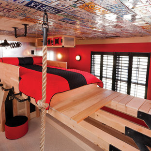 Photo of a small industrial loft-style bedroom in DC Metro with red walls, carpet, no fireplace and beige floor.