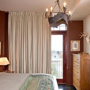 Ejemplo de dormitorio tipo loft, moderno, de tamaño medio, con paredes rojas, chimenea de esquina, marco de chimenea de yeso y suelo de cemento