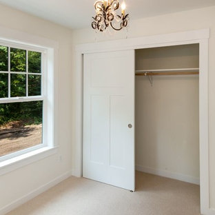 Mid-sized elegant master carpeted and beige floor bedroom photo in Seattle with white walls and no fireplace