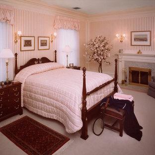 Ejemplo de dormitorio principal, clásico, de tamaño medio, con moqueta, chimenea tradicional, marco de chimenea de baldosas y/o azulejos y suelo rosa