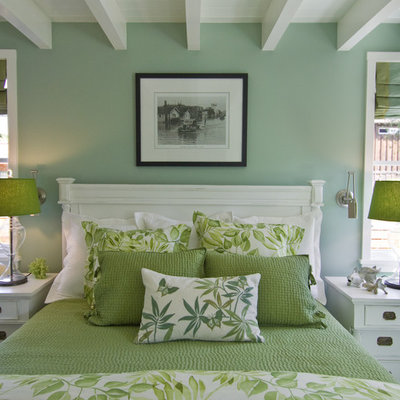 Beach style bedroom photo in San Francisco with green walls