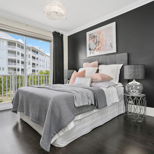 This is an example of a transitional bedroom in Sydney with black walls and black floor.