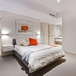 Photo of a large contemporary master bedroom in Perth with beige walls, carpet, no fireplace and beige floor.
