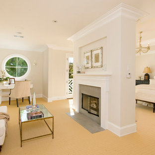 Design ideas for a classic bedroom in Los Angeles with beige walls, carpet, a two-sided fireplace and beige floors.