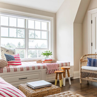 Inspiration for a beach style bedroom in Other with beige walls, dark hardwood flooring and brown floors.