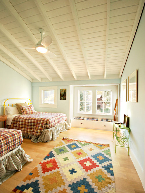 Large country guest light wood floor and brown floor bedroom photo in Other  with blue walls