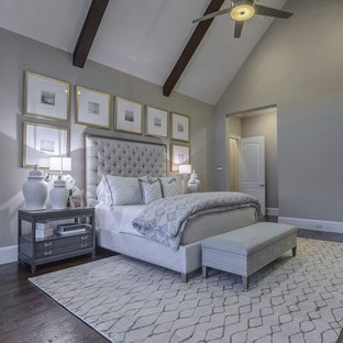 Large transitional master bedroom in Dallas with grey walls, dark hardwood floors, a two-sided fireplace and a stone fireplace surround.