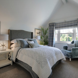 This is an example of a medium sized beach style bedroom in London with grey walls, carpet, no fireplace and beige floors.