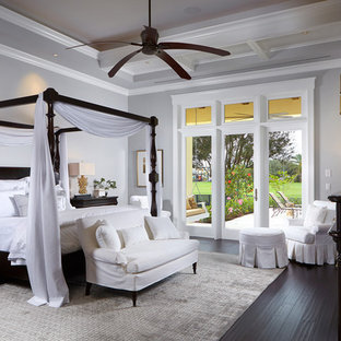 Island style bedroom photo in Miami with gray walls