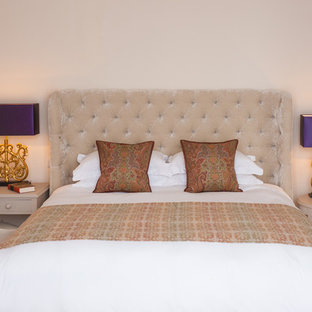 Bedroom - traditional master carpeted bedroom idea in Sussex with beige walls