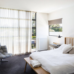 Photo of a contemporary guest bedroom in Melbourne with white walls, carpet and grey floor.