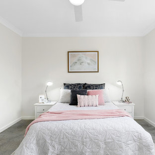 This is an example of a transitional bedroom in Brisbane with white walls, carpet and grey floor.