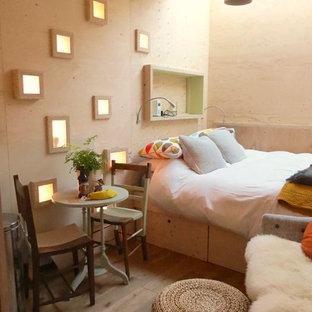 Example of a trendy light wood floor bedroom design in Other