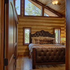 Rustic Bedroom by Satterwhite Log Homes