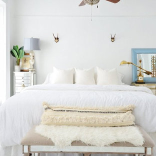 Eclectic painted wood floor bedroom photo in New York with white walls