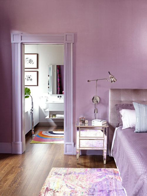 Inspiration for a contemporary brown floor bedroom remodel in New York with  purple walls