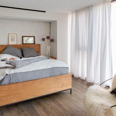 Bedroom - mid-sized scandinavian master dark wood floor and brown floor bedroom idea in New York with white walls and no fireplace